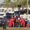 Photo - Rescue workers remove Memo Gidley, center, from his Corvette DP after he was involved in a crash during the IMSA Series Rolex 24 hour auto race at Daytona International Speedway in Daytona Beach, Fla., Saturday, Jan. 25, 2014. (AP Photo/David Graham)