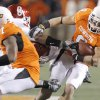 Photo - Oklahoma State's Bo Bowling, right, runs through the Oklahoma defense.  Photo by Chris Landsberger, The Oklahoman