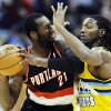 Denver Nuggets forward Kenneth Faried (35) pressures Portland Trail Blazers center J.J. Hickson (21) during the third quarter of an NBA basketball game, Tuesday, Jan. 15, 2013, in Denver. (AP Photo/Jack Dempsey)