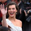 Milla Jovovich arrives before the 84th Academy Awards on Sunday, Feb. 26, 2012, in the Hollywood section of Los Angeles. (AP Photo/Joel Ryan) ORG XMIT: OSC154