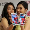 Models pose with LG Electronics\' new smartphone Optimus G Pro during a press conference in Seoul, South Korea, Monday, Feb. 18, 2013. LG Electronics Inc. said its Optimus G Pro smartphone with a full high-definition screen will go on sale in South Korea this week and hit shelves in Japan in April. (AP Photo/Ahn Young-joon)
