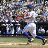 Photo - New York Mets third baseman David Wright hits an RBI single  in the first inning of game one in a double header baseball game at Citi Field on Sunday, May 25, 2014, in New York. (AP Photo/Kathy Kmonicek)