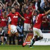 Photo - Manchester United's Robin Van Persie, left, celebrates his goal against Wigan Athletic with teammate Rafael during their English FA Community Shield soccer match at Wembley Stadium in London, Sunday, Aug. 11, 2013. (AP Photo/Jon Super)