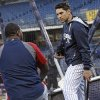 Photo - New York Yankees' Jacoby Ellsbury, right, talks with former teammate and Boston Red Sox designated hitter David Ortiz before a baseball game at Yankee Stadium in New York, Thursday, April 10, 2014. (AP Photo/Kathy Willens)