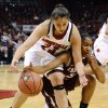 Photo -   Louisville's Shoni Schimmel, left, battles Eastern Kentucky's LaRa'e Allen for a loose ball during the first half of their NCAA college basketball game, Wednesday, Nov. 28, 2012, in Louisville, Ky. (AP Photo/Timothy D. Easley)