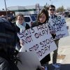 Photo -  Norman High School students stand with signs in protest of anti-abortion group's signs in front of Norman High School on Wednesday. Photo by Steve Sisney, The Oklahoman  <strong>STEVE SISNEY -   </strong>