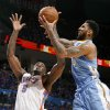 Oklahoma City\'s Kendrick Perkins (5) goes for the basket beside Denver\'s Wilson Chandler (21) during the NBA basketball game between the Denver Nuggets and the Oklahoma City Thunder in the first round of the NBA playoffs at the Oklahoma City Arena, Sunday, April 17, 2011. Photo by Bryan Terry, The Oklahoman