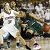 Edmond Santa Fe\'s Courtney Walker (23) drives the ball against Edmond Memorial\'s Toree Thompson (30) during the Class 6A girls high school basketball state tournament championship game between Edmond Santa Fe and Edmond Memorial at the Mabee Center in Tulsa, Okla., Saturday, March 10, 2012. Santa Fe won, 44-41. Photo by Nate Billings, The Oklahoman