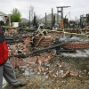 Floyd Craft walks in front of what remains of his home at 1143 Village in Oakwood East Royale neighborhood. The house was reduced to ashes and rubble, but in a twist of irony, his outdoor storage shed was spared. Photo by Jim Beckel, The Oklahoman