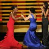 "Uzo Aduba, left, presents the award for outstanding directing for a comedy series to Gail Mancuso for her work on ""Modern Family"" at the 66th Annual Primetime Emmy Awards at the Nokia Theatre L.A. Live on Monday, Aug. 25, 2014, in Los Angeles. (Photo by Chris Pizzello/Invision/AP)"