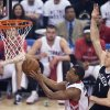 Photo - Toronto Raptors guard Kyle Lowry, left, drives to the net past Brooklyn Nets forward Mason Plumlee, right, during the first half of Game 5 of the opening-round NBA basketball playoff series in Toronto, Wednesday, April 30, 2014. (AP Photo/The Canadian Press, Nathan Denette)
