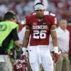 Oklahoma\'s Jordan Evans (26) leaves after getting ejected from the game on a penalty during a college football game between the University of Oklahoma Sooners (OU) and the Louisiana Tech Bulldogs at Gaylord Family-Oklahoma Memorial Stadium in Norman, Okla., on Saturday, Aug. 30, 2014. Photo by Bryan Terry, The Oklahoman