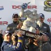 Photo -   Brad Keselowski hoists the trophy as he celebrates his win in victory lane at the NASCAR Sprint Cup Series auto race at Dover International Speedway, Sunday, Sept. 30, 2012, in Dover, Del. (AP Photo/The Wilmington News-Journal, Daniel Sato) NO SALES