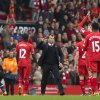 Photo - Liverpool's manager Brendan Rodgers, centre, celebrates with his players after their 4-0 win against Tottenham in their English Premier League soccer match at Anfield Stadium, Liverpool, England, Sunday March 30, 2014. (AP Photo/Jon Super)