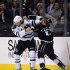 Photo - Dallas Stars left wing Antoine Roussel, left, of France, and Los Angeles Kings left wing Daniel Carcillo fight during the first period of their NHL hockey game, Saturday, Oct. 19, 2013, in Los Angeles.  (AP Photo/Mark J. Terrill)