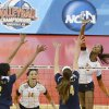 Texas outside hitter Bailey Webster, right, attempts to spike the ball past the defense of Michigan\'s Krystalyn Goode, left, and Claire McElheny during the national semifinals of the NCAA college women\'s volleyball tournament Thursday, Dec. 13, 2012 in Louisville, Ky. (AP Photo/Timothy D. Easley)