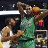 Boston Celtics\' Kevin Garnett (5) looks to pass as Golden State Warriors\' Festus Ezeli defends during the first half of an NBA basketball game in Oakland, Calif., Saturday, Dec. 29, 2012. (AP Photo/George Nikitin)
