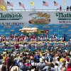 The Nathan\'s Famous Fourth of July International Hot Dog Eating contest men\'s competition kicks off in front of crowds of fans at Coney Island, Thursday, July 4, 2013 at Coney Island, in the Brooklyn borough of New York. (AP Photo/John Minchillo)