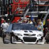 Jeff Burton drives Tony Stewart\'s No. 14 car through the garage to to practice for the NASCAR Sprint Cup Series auto race at Michigan International Speedway in Brooklyn, Mich., Friday, Aug. 15, 2014. A