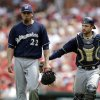 Photo - Milwaukee Brewers starting pitcher Matt Garza, left, gets a pat from catcher Jonathan Lucroy after working the fourth inning of a baseball game against the St. Louis Cardinals, Sunday, Aug. 3, 2014, in St. Louis. (AP Photo/Jeff Roberson)