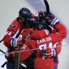 Washington Capitals defenseman John Carlson (74) celebrates his second-period goal with teammates during Game 3 against the New York Rangers in their NHL hockey Stanley Cup second-round playoff series at the Verizon Center in Washington, Wednesday, May 2, 2012. (AP Photo/Susan Walsh)