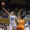 Duke\'s Haley Peters (33) drives to the basket against Oklahoma State\'s Kendra Suttles (31) during the first half of a second-round game in the women\'s NCAA college basketball tournament in Durham, N.C., Tuesday, March 26, 2013. Duke won 68-59. (AP Photo/Gerry Broome)