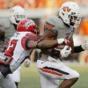 OSU\'s Joseph Randle tries to break away from ULL\'s Melvin White in the first quarter of their game Saturday in Stillwater. Photo by Nate Billings, The Oklahoman