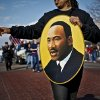 State Representative Anastasia Pittman carries a portrait of Martin Luther King Jr. during the Martin Luther King Jr. parade in downtown on Monday, Jan. 17, 2011, in Oklahoma City, Okla. . Photo by Chris Landsberger, The Oklahoman