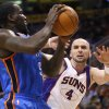 Photo - Oklahoma City Thunder center Kendrick Perkins battles Phoenix Suns center Marcin Gortat, of Poland, for the ball during the first half of an NBA basketball game, Wednesday, April 18, 2012, in Phoenix. (AP Photo/Matt York)  ORG XMIT: PNU101