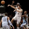 Brooklyn Nets\' Deron Williams, center, passes through Memphis Grizzlies defense during the first half of the NBA basketball game at the Barclays Center Sunday, Feb. 24, 2013 in New York. (AP Photo/Seth Wenig)