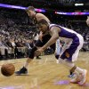 Memphis Grizzlies\' Marc Gasol, left, of Spain, and Phoenix Suns\' Markieff Morris battle for a loose ball during the first half of an NBA basketball game on Wednesday, Dec. 12, 2012, in Phoenix. (AP Photo/Matt York)