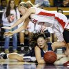 Shawnee\'s Micaela Yu (25) loses the ball as she hits the court underneath Carl Albert\'s Asher Sutterfield (23) during a Class 5A girls high school basketball game in the semifinals of the state tournament at the Mabee Center in Tulsa, Okla., Friday, March 8, 2013. Shawnee defeated Carl Albert, 50-46, in overtime. Photo by Nate Billings, The Oklahoman