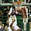 Photo - Baylor forward Cory Jefferson (34) dunks over Charleston Southern's Allie Fullah (35) in the first half of an NCAA college basketball game, Wednesday, Nov. 20, 2013, in Waco, Texas. (AP Photo/Tony Gutierrez)