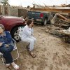 Mary Barnhill, left, sits next to her daughter-in-law Brenda Barnhill after a tornado destroyed the home of Brenda Barnhill and her husband Larry Barnhill, Mary\'s son, near SW 149th and Vicki Dr., when a tornado struck south Oklahoma City and Moore, Okla., Monday, May 20, 2013. Photo by Nate Billings, The Oklahoman