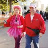 John and Debbie Garrett, OKC, walk near the finish line during the 20th annual Susan G. Komen Race for the Cure in downtown Oklahoma City Sunday, October 20, 2013. Debbie is a 6 year survivor. Photo by Doug Hoke, The Oklahoman