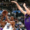 Photo - OKLAHOMA CITY THUNDER / NBA BASKETBALL: Oklahoma City's Kevin Durant looks for a shot despite pressure from Sacramento's Spencer Hawes during the second half of their game at the Ford Center in Oklahoma City on Sunday, Feb. 8, 2009. The Thunder beat the Kings 116-113. By John Clanton, The Oklahoman ORG XMIT: KOD