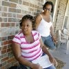 Sisters Cleta Jennings, Antwun Parker\'s mother, and Sharon Jennings, Antwun\'s aunt, on Sharon\'s front porch talk about Antwun in Oklahoma City Friday, May 29, 2009. Parker, 16, was killed by pharmacist Jerome Jay Ersland during an attempted robbery of Reliable Discount Pharmacy, 5900 S Pennsylvania Ave, on May 19, 2009. Photo by Paul B. Southerland, The Oklahoman