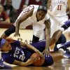 Oklahoma Sooner\'s Aaryn Ellenberg (3) is called for a foul as she and TCU Horned Frog\'s Natalie Ventress (24) fight for a loose ball in the second half as the University of Oklahoma Sooners (OU) defeat the Texas Christian University Horned Frogs (TCU) 63-52 in NCAA, women\'s college basketball at The Lloyd Noble Center on Saturday, Jan. 25, 2014 in Norman, Okla. Photo by Steve Sisney, The Oklahoman