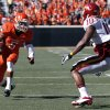 Oklahoma State\'s Josh Stewart (5) looks to get by Iowa State\'s Jacques Washington (10) during a college football game between Oklahoma State University (OSU) and Iowa State University (ISU) at Boone Pickens Stadium in Stillwater, Okla., Saturday, Oct. 20, 2012. Photo by Sarah Phipps, The Oklahoman