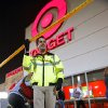 Hunter Witt, Assets Protection leader at Target, takes down security tape as the line in front of the store thins at the midnight opening on Black Friday, Nov. 25, 2011, in Moore, Okla. Photo by Steve Sisney, The Oklahoman