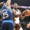 The Thunders' Kyle Weaver, right, tries to get past the Mavericks' Erick Dampier during first-half action on Monday. OKC beat Dallas 96-87 Photo BY NATE BILLINGS, THE OKLAHOMAN