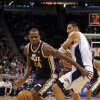 Utah Jazz power forward Paul Millsap (24) drives around Orlando Magic power forward Gustavo Ayon (19) during the first half of an NBA basketball game, Sunday, Dec. 23, 2012, in Orlando, Fla. (AP Photo/Scott Iskowitz)