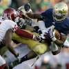 Notre Dame\'s George Atkinson III (4) is tackled by Oklahoma\'s Geneo Grissom, behind, during the second half of an NCAA college football game on Saturday, Sept. 28, 2013, in South Bend, Ind. Oklahoma defeated Notre Dame 35-21. (AP Photo/Darron Cummings) ORG XMIT: INDC120