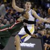 Milwaukee Bucks\' Monta Ellis passes away from Golden State Warriors\' Klay Thompson during the second half of an NBA basketball game Saturday, March 9, 2013, in Oakland, Calif. (AP Photo/Ben Margot)