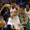 Oklahoma City\'s Thabo Sefolosha (25) and Boston\'s Avery Bradley (0) chase down a loose ball during the NBA game between the Oklahoma City Thunder and the Boston Celtics at the Chesapeake Energy Arena., Sunday, Jan. 5, 2014. Photo by Sarah Phipps, The Oklahoman