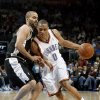 Oklahoma City\'s Russell Westbrook (0) drives past San Antonio\'s Tony Parker (9) during the NBA game between Oklahoma City and San Antonio, Tuesday April 7, 2009, at the Ford Center in Oklahoma CIty. Photo by Sarah Phipps, The Oklahoma