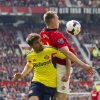 Photo - Manchester United's Phil Jones, right, fights for the ball against Sunderland's Fabio Borini, during their English Premier League soccer match at Old Trafford Stadium, Manchester, England, Saturday May 3, 2014. (AP Photo/Jon Super)