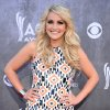 """Photo - FILE-- In this April 6, 2014 file photo, Jamie Lynn Spears arrives at the 49th annual Academy of Country Music Awards at the MGM Grand Garden Arena, in Las Vegas. The former teen star of """"Zoey 101"""" has been working behind the scenes in Nashville learning the craft of songwriting. She's already got a music video and put out an EP called """"The Journey"""" on iTunes with five new songs. (Photo by Al Powers/Powers Imagery/Invision/AP, file)"""