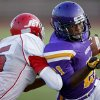 Northwest Classen\'s Lorenzo Alexander scores a touchdown past Western Heights\' Davonte Drennan during a high school football game at Taft Stadium in Oklahoma City, Thursday, September 20, 2012. Photo by Bryan Terry, The Oklahoman
