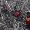 Rescuers retrieve flash flood victims from the debris of Tuesday\'s Typhoon Bopha at New Bataan township, Compostela Valley in southern Philippines Friday Dec. 7, 2012. Rescuers were digging through mud and debris Friday to retrieve more bodies strewn across a farming valley in the southern Philippines by a powerful typhoon. (AP Photo/Bullit Marquez)